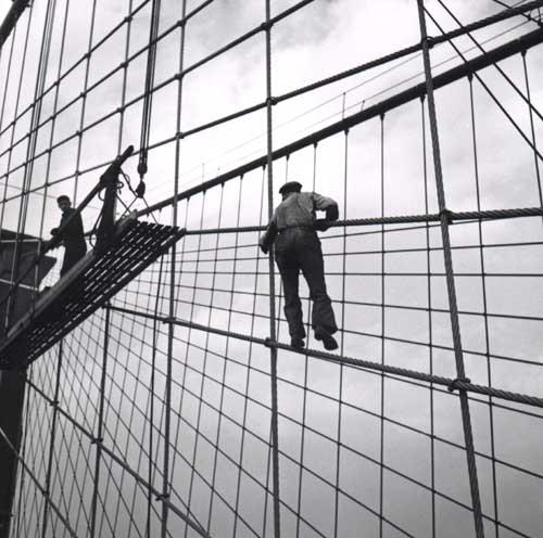 Painter climbing up to scaffold on the Brooklyn Bridge