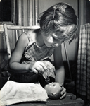 girl feeding doll