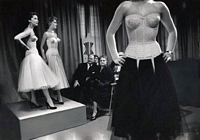 3 models wearing corsets on runway