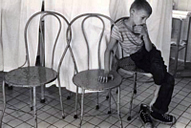 boy, 3 chairs