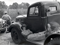 cowboy asleep on running board